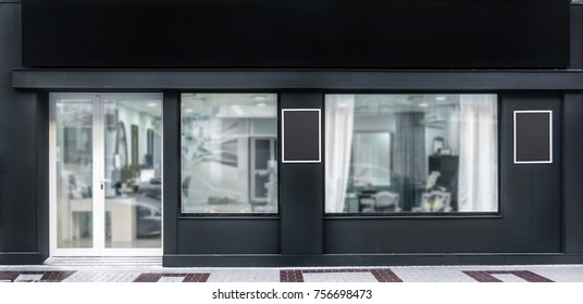Outdoor mock up,store template,front view black shop facade with windows display, three posters.