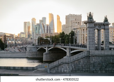 Outdoor Moscow city landscape in golden sunset lights, urban Russia. Old city and modern skyscrapers architecture of Moscow. Architecture landmark of Russia. Travel and explore city downtown at sunset
