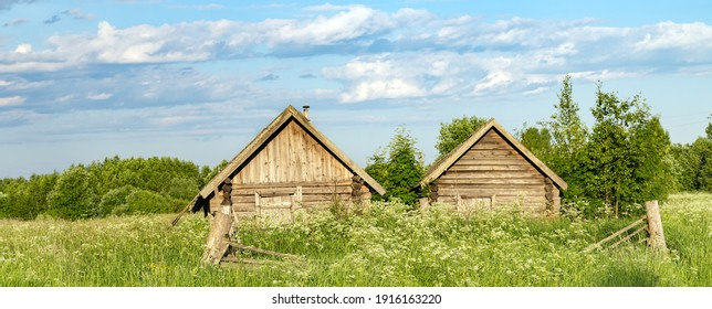 Outdoor old wooden sauna hut summer meadow forest landscape