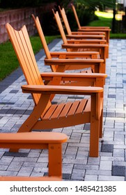 Outdoor Orange Chairs Repeated in a Line (Deep Depth of Field)