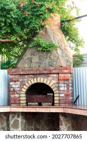Outdoor oven-barbecue made of brick. Vacation in the country.