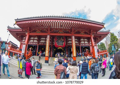 Outdoor panoramic scenic view of front enter Sensoji shrine crowded with queuing believers in Sensoji temple, Asakusa, Tokyo, Japan in March 15 2018. It's famous Shinto temple in Tokyo.