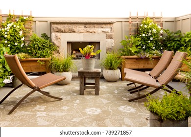 An outdoor patio complete with gas fireplace.