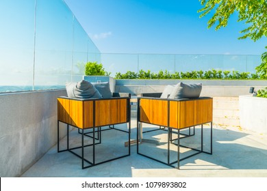 Outdoor patio decoration with char and table on blue sky