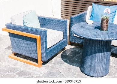 Outdoor patio with empty chair and table - Vintage Light Filter