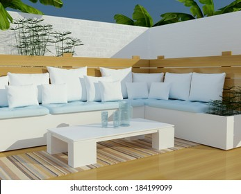 Outdoor patio seating area with big white sofa and table.