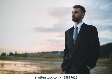 Outdoor photo of an businessman in black suit