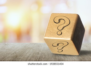 Outdoor photo of a wooden box with a big question mark printed