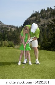 Outdoor photo of young girl at golf lesson.