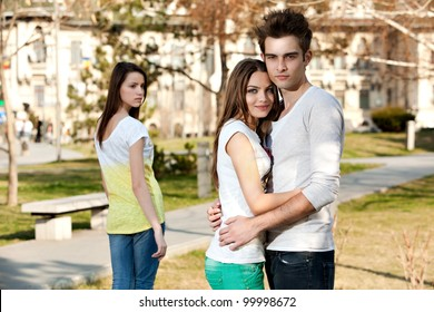 outdoor photo of a young woman jealous on a happy couple