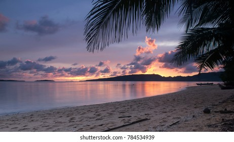 Outdoor photography of a tropical beach at sunset. Location: Pulau Bangka (North Sulawesi/Indonesia)