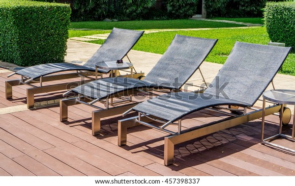 Cool Outdoor Poolside Couch Chairs Wooden Benches Stock Photo Interior Design Ideas Pimpapslepicentreinfo