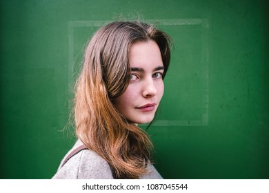 outdoor portait of a smiling young woman