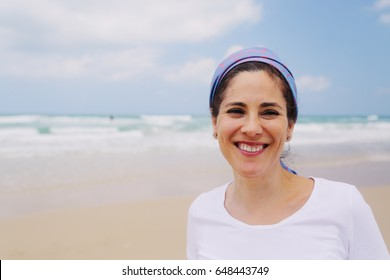 Outdoor portrait of 40 years old woman
