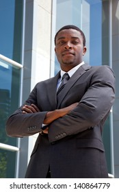 Outdoor portrait of an African business man with his arms folded