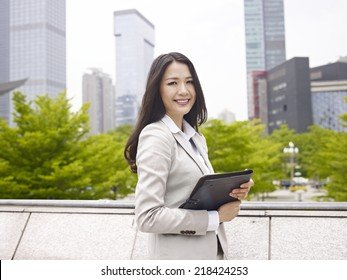 outdoor portrait of an asian businesswoman.