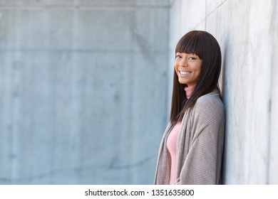 Outdoor portrait of beautiful African American woman outside wit
