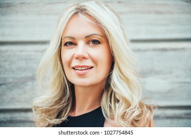 Outdoor portrait of beautiful blond woman, close up, beauty concept