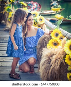 Outdoor portrait of a beautiful happy family. Mother and daughter together