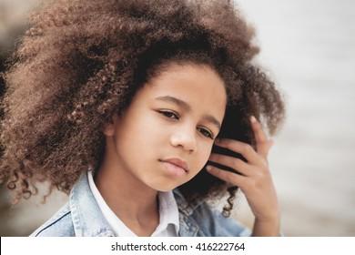 Outdoor portrait of a beautiful little girl
