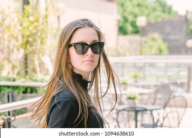 Outdoor portrait of beautiful teenage girl with long hair
