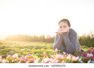 outdoor portrait of a beautiful  woman. attractive sexy girl in a field with flowers