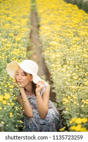 outdoor portrait of a beautiful woman in a field with flowers. Art work of romantic woman. summer holidays, vacation and people concept