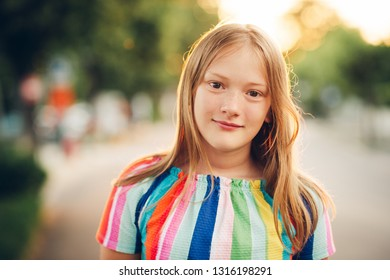 Outdoor portrait of beautiful young girl in sunlight, close up image