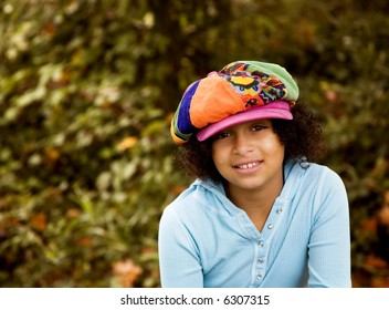 outdoor portrait of biracial girl shot in the fall