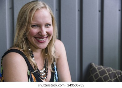 Outdoor portrait of blonde woman laughing
