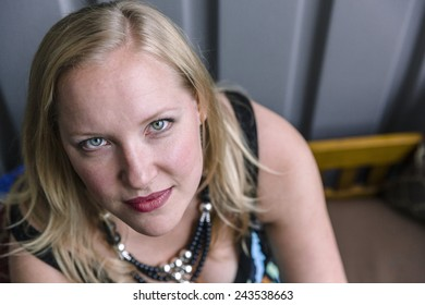 Outdoor portrait of blonde woman looking up