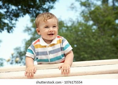 outdoor portrait of a boy. funny child on walk in the summer park