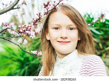 Outdoor portrait of a cute little girl, on a nice spring day