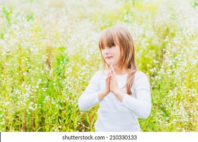 Outdoor, portrait of a cute little girl