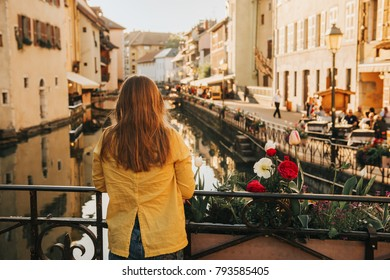 Outdoor portrait of a cute little girl looking at beautiful canal in Annecy, France. Travel with kids