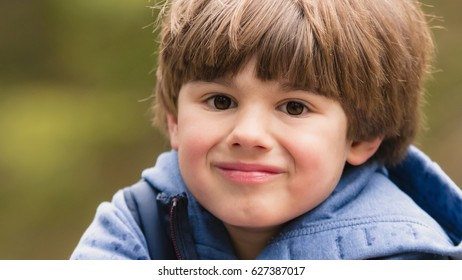 Outdoor portrait of cute young boy. Close up.