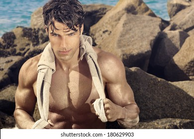 Outdoor portrait of a fit sexy fit man