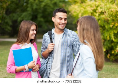 Outdoor portrait of a group of smiling students
