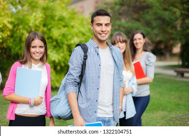 Outdoor portrait of a group of students in front of their school