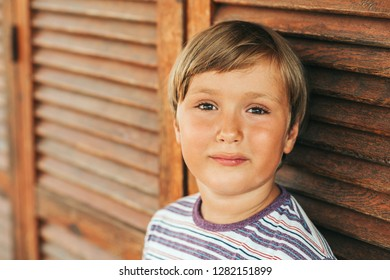 Outdoor portrait of handsome young boy, close up image