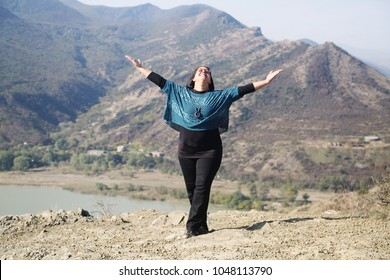 Outdoor portrait of happy 40 years old woman
