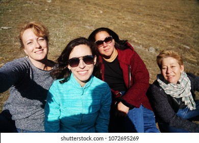 Outdoor portrait of happy 45 years old woman traveling together