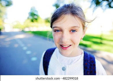 Outdoor portrait of happy girl 10-11 year old with backpack. Back to school e192c43c24693