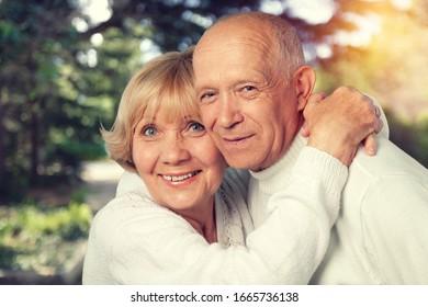 Outdoor portrait of a happy loving senior couple