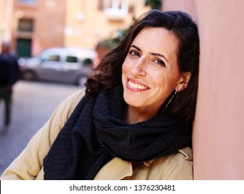 Outdoor portrait of happy smiling woman