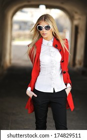 Outdoor portrait of high fashion female posing in the city