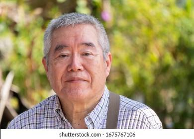 Outdoor portrait of Japanese elderly man