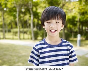 outdoor portrait of a little asian boy.