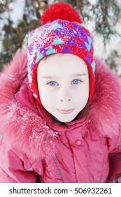 Outdoor portrait of a little pretty girl wearing winter clothes