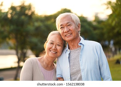 outdoor portrait of loving senior asian couple, happy and smiling